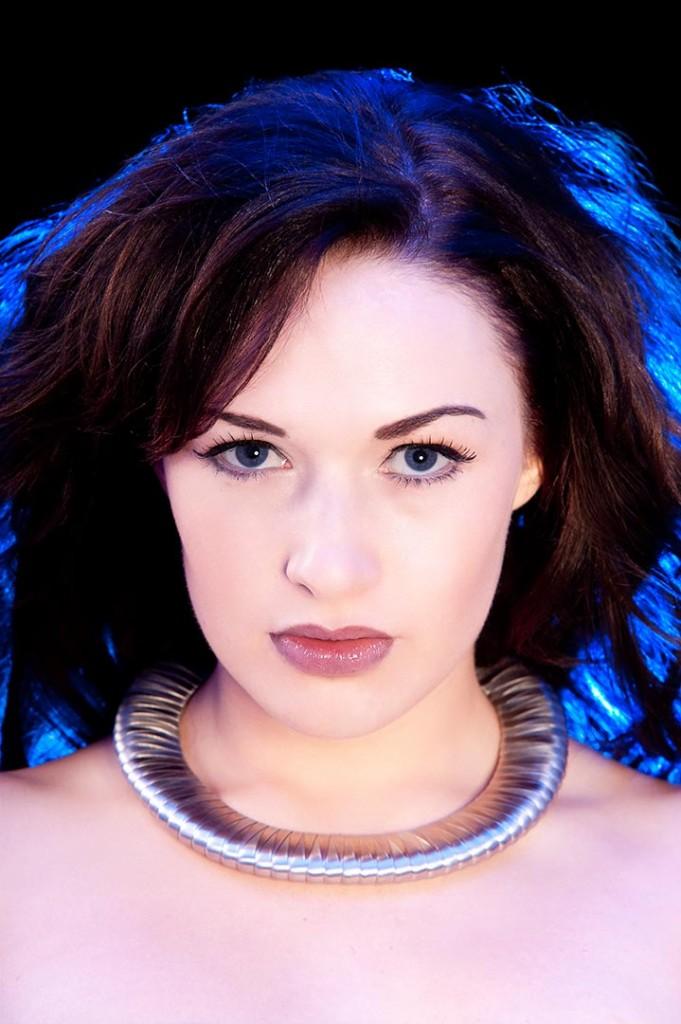 Dramatic portrait using blue light rim effect.