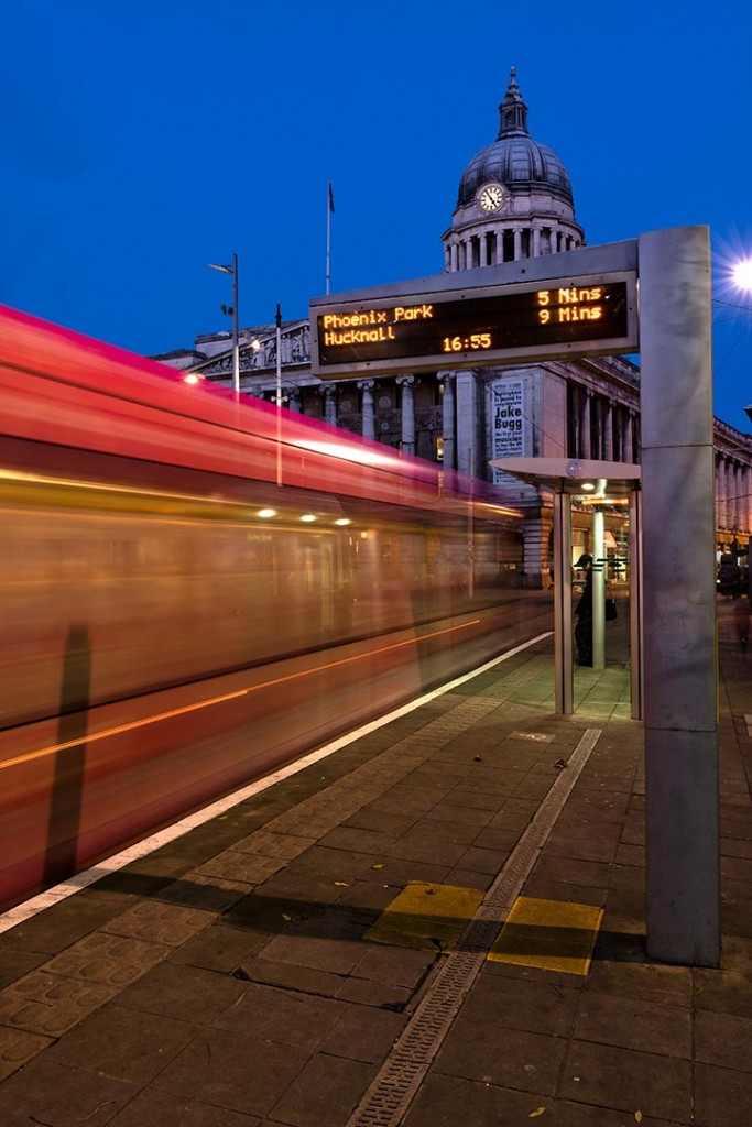 Architectural shot of tram passing through Nottingham's Market Square