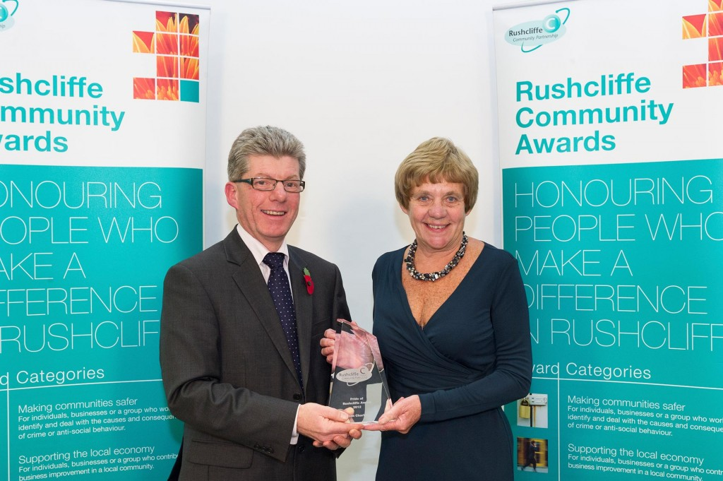 Winner presented with an award at the Rushcliffe Community Awards 2012.